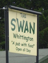 Picture of the sign outside the Swan Pub - it says The Swan, Whittington, A pub with food Open all day.
