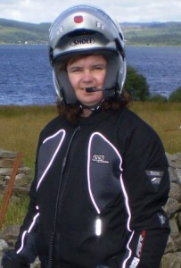 picture of cathy in her bike jacket and helmet.