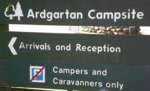 Picture of the campsite sign at arrivals and reception.