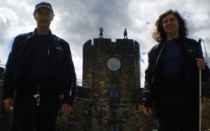 Picture of Cathy and Bernard with the clock tower inbetween them. The clock tower and forecourt featured in the flying scene where the apprentices are learning to use their broomsticks - where Neville got out of control and Harry went to rescue him!