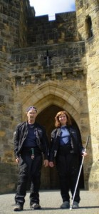 Picture of Cathy and Bernard standing at the Gateway through which Harry Potter makes various entrances. It is an arched Gateway about 15 feet tall by ten foot wide. It is not the main entrance to the castle which is on the opposite side of the building.
