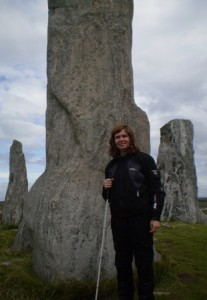 Picture of Cathy at the standing stones of Callanish. She had her long cane with her.