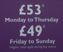 Picture of the famous sign offering rooms for £53 although noting 'Higher rates apply during key events'.