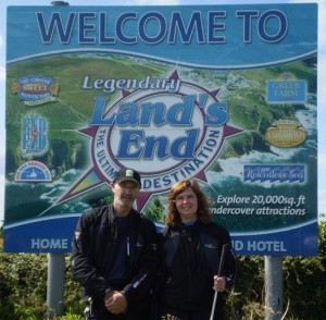 icture of Cathy and Bernard infront of the 'Welcome to Land's End' sign on the approach road to the car park.