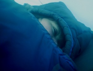 """Picture of Cathy deeply wrapped up in her sleeping bag. Since we bought this one she purrs at night. The sleeping bag is called """"The Cat's Meow"""" and it is made by North Face."""