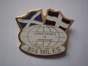 Picture of the Land's End to John O'Groats badge indicating the 874 miles between the two points.