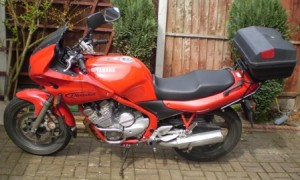 Picture of the red Yamaha Bernard uses for work.