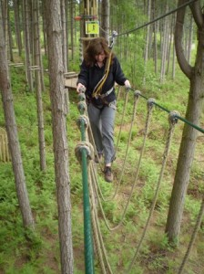 picture of cathy crossing a rope bridge at Go Ape