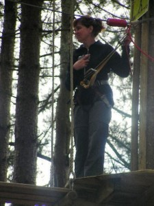 Picture of Cathy up in the trees attached to a safety harness