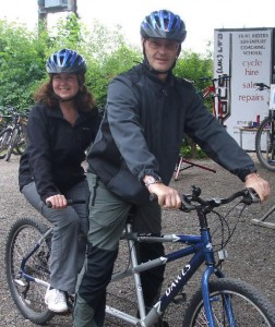 Picture of Bernard and Cathy on a tandem. Bernard is on the front!