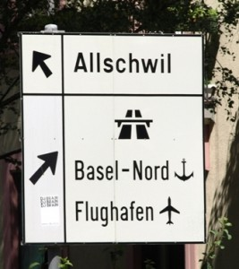 Picture of road sign showing direction to Allschwil district.