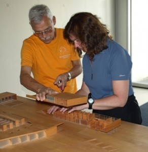 Picture of Bruno showing Cathy layout of centre using specially constructed model.