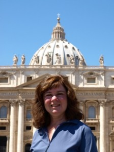 Picture of cathy at Vatican with Bassilica in background.