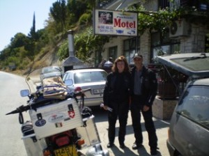 Picture of cathy and bernard in outside the first motel in Montenegro.