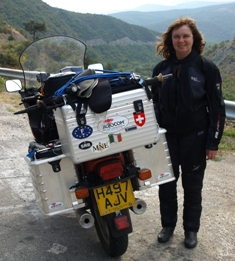 picture of cathy beside the bike showing all the stickers on the back including the SRB sticker.