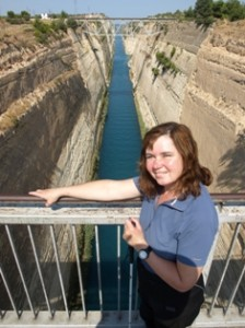 Picture of Cathy on the bridge over the Corinth Canal which is below her.