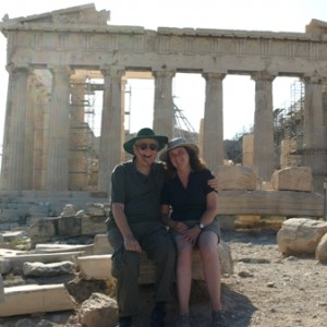 Picture of Jim and Cathy sitting together amongst the ruins of what once was.