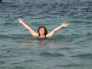 Picture of Cathy waving from the sea.