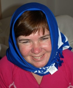 Picture of Cathy wearing a headscarf.