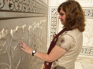 Picture of Cathy exploring the craftsmanship of the marble flowers.