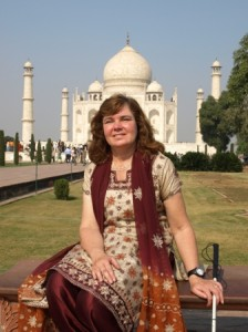 Picture of Cathy with the Taj Mahal behind her.