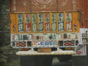 Picture of the thing we came to loath the most - Indian wagons with their Blow Horn signs painted on the rear.