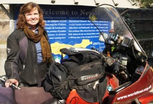 Picture of Cathy by the bike after we have crossed the Nepal Border.