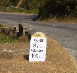 Picture of the stone marker beside the road - still 100kms to go!