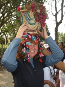 Picture of Cathy holding a Tharu 'head-dress' in place