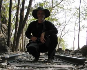 Picture of Bernard inbetween the railway tracks of the Thai-Burma railway at Hellfire Pass.