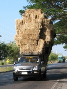 Picture of one of the Thai pick-up trucks loaded with bales of straw.