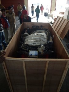 Picture of Bertha in a box of bits at Kathmandu customs house.