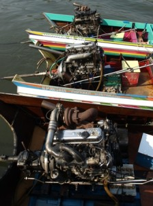 Picture of the engines strapped onto the back of the river boats.