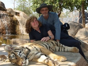 Picture of Bernard and Cathy with a sleeping tiger.