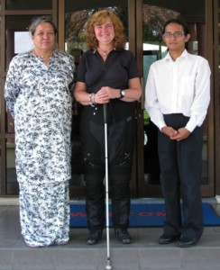 Picture of Cathy with Suliyati and another member of staff on the steps of reception.