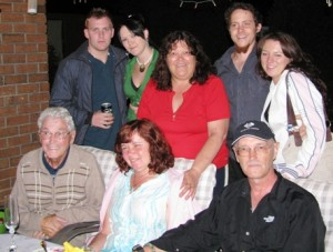 Picture of the gathering of the clan, including, Jacquie (behind Cathy) with her daughter (Katie on left) and Sarah behind Bernard.