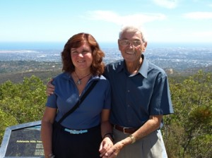 Picture of Cathy and Pat at Mount Lofty with Adelaide stretched out behind them.