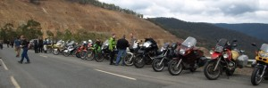Picture of some of the bikes parked on the dam itself.