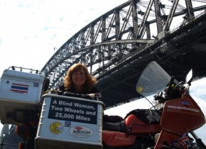 Picture of Cathy with the bike underneath the Harbour Bridge. She is smiling as we have not tried to start Bertha up yet and when we do, she will not turn over!