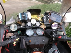 Picture of Bertha's dashboard which has become more cluttered the further from home have we travelled!