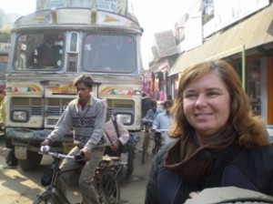 Picture of Cathy just after crossing the border out of India - she has a big smile on her face.