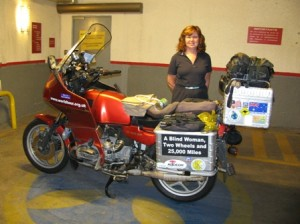 Picture of Cathy standing nby the bike in the underground car park in Santiago at the hotel.
