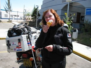 Picture of Cathy eating her icecream at the border post.