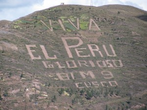 "Picture of writing carved into the hills above Cusco which reads ""Viva El Peru, Glorioso, BLM 9""."