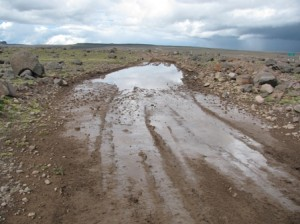 Picture of the old road which had many of its sections flooded, leaving it muddy and wet.