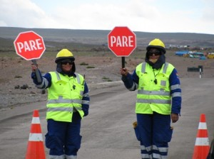 Picture of Gwen and her colleague waving their stop/go paddles minutes before the road reopened.