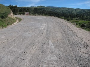 Picture of one of the better stretches of road. The surface is covered with a fine grey gravel the likes of which reminded Bernard of cat litter!
