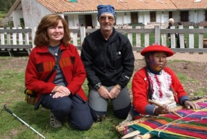 Picture of Cathy and Bernard sat behing the old lady weaving at the frame.
