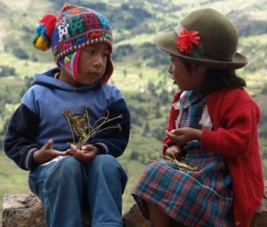 Picture of the young boy and girl (about 5 years old) talking on the wall.