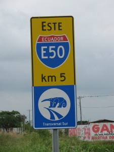 Picture of a road sign which says Ecuador E50 five kilometers.